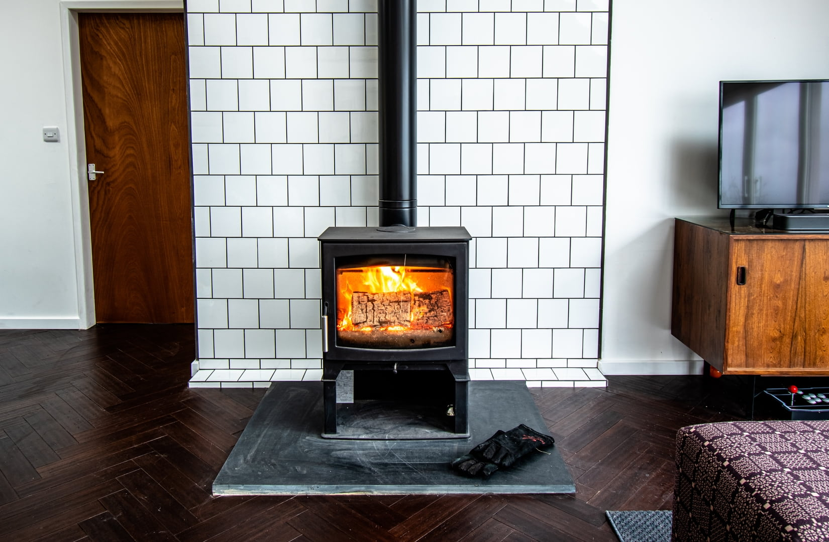 The living area is heated by a wood burner