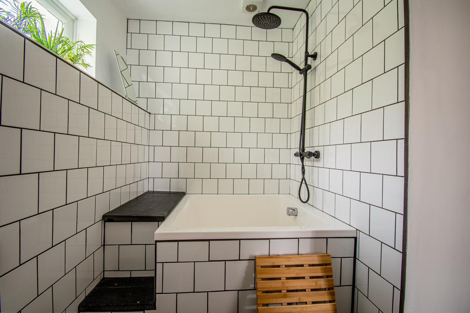 Japanese deep bath & overhead shower in the family bathroom